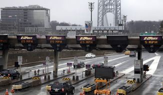FILE- In this Jan. 11, 2014, file photo, traffic passes through the toll booths at the George Washington Bridge, in Fort Lee, N.J. New Jersey Gov. Chris Christie appears to have largely moved past the lane-closing scandal. What happens next will depend largely on the outcome of the investigation by the U.S. Attorney in New Jersey into the lane realignments that started a year ago Tuesday, Sept. 9, on the George Washington Bridge. (AP Photo/Richard Drew, File)
