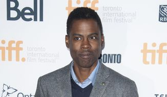 "Chris Rock poses at the ""Top Five"" premiere at the Princess of Wales Theatre during the 2014 Toronto International Film Festival on Saturday, Sept. 6, 2014, in Toronto. (Photo by Arthur Mola/Invision/AP) ** FILE **"