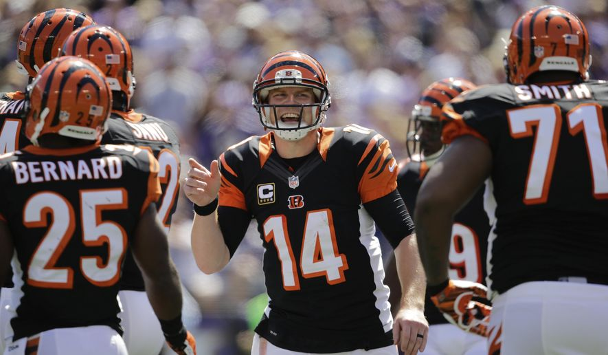 Cincinnati Bengals quarterback Andy Dalton (14) rallies the offense during the first half of an NFL football game against the Baltimore Ravens in Baltimore, Md., Sunday, Sept. 7, 2014. (AP Photo/Patrick Semansky)