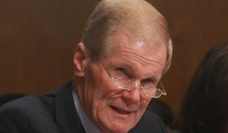 Sen. Bill Nelson, Florida Democrat, is hammering out a legislative proposal to authorize U.S. military strikes on Islamic State targets within Syria. (associated press)