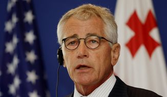 U.S. Defense Secretary Chuck Hagel speaks to press at a news conference in Tbilisi, Georgia, Sunday, Sept. 7, 2014. In the face of growing aggression by Russia, the United States and Georgia moved Sunday to expand their defense relationship — including the possible sale of U.S. Black Hawk helicopters to the former Soviet bloc nation at the crossroads of eastern Europe and Asia.(AP Photo/Shakh  Aivazov)