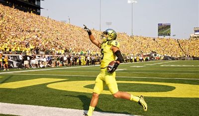 Oregon Ducks Devon Allen celebrates his second quarter touchdown against the Michigan State Spartans at Autzen Stadium, in Eugene, Oregon, Saturday, Sept, 6, 2014.(AP Photo/The Oregonian, Thomas Boyd)  MAGS OUT; TV OUT; LOCAL TELEVISION OUT; LOCAL INTERNET OUT; THE MERCURY OUT; WILLAMETTE WEEK OUT; PAMPLIN MEDIA GROUP OUT