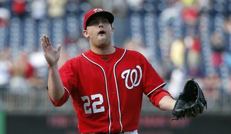 Washington Nationals relief pitcher Drew Storen celebrates after the last out during a baseball game against the Philadelphia Phillies at Nationals Park, Sunday, Sept. 7, 2014, in Washington. The Nationals won 3-2. (AP Photo/Alex Brandon)
