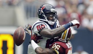 Washington Redskins' Bashaud Breeland (26) breaks up a pass intended for Houston Texans' Andre Johnson (80) during the first quarter of an NFL football game Sunday, Sept. 7, 2014, in Houston. (AP Photo/David J. Phillip)