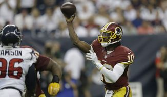Washington Redskins quarterback Robert Griffin III (10) makes a pass during the fourth quarter of an NFL football game Sunday, Sept. 7, 2014, in Houston. Houston won 17-6. (AP Photo/David J. Phillip)