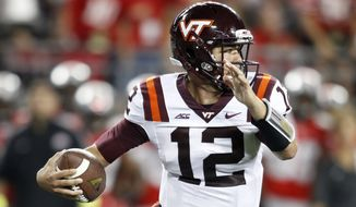 Virginia Tech quarterback Michael Brewer scrambles against Ohio State during the first quarter of an NCAA college football game Saturday, Sept. 6, 2014, in Columbus, Ohio. (AP Photo/Paul Vernon)