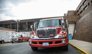District of Columbia ambulances wait for emergency calls outside Howard University Hospital, in Washington, DC., Wednesday, August 7, 2013. (Andrew S Geraci/The Washington Times)