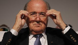 """FILE - In this July 2, 2014 file photo, FIFA President Sepp Blatter puts on his glasses as he prepares to speak about the World Cup's impact on Brazilian soccer, during a sports management seminar at the Maison de France theater in downtown Rio de Janeiro, Brazil. Blatter will run for a fifth, four-year term as FIFA president. """"I will make an official declaration definitely in September now when we have the executive committee,"""" the Swiss official said in a pre-recorded interview shown Monday, Sept. 8, 2014 at a SoccerEx conference. (AP Photo/Leo Correa, File)"""