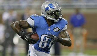 Detroit Lions wide receiver Calvin Johnson runs for a 67-yard touchdown reception during the first quarter of an NFL football game against the New York Giants in Detroit, Monday, Sept. 8, 2014. (AP Photo/Carlos Osorio)