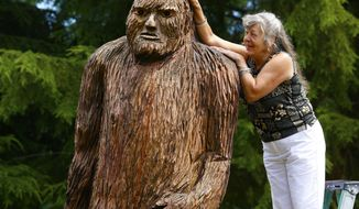 "Pearl Prihoda, official historian for Bigfootology, has a giant carved Sasquatch named Wowie in her Granite Falls, Wash., yard, on Aug. 5, 2014. The Washington region was a major contributor of hair samples to a study done at the University of Oxford, hairs thought to come from the elusive being. The results, revealed  in July, published in the prestigious Proceedings of the Royal Society B (""B"" for biological sciences) concluded that the hairs were from raccoons, horses, bears, cows, wolves _ not some unknown mammal. (AP Photo/The Seattle Times, Mark Harrison) (AP Photo/The Seattle Times, Mark Harrison) OUTS: SEATTLE OUT, USA TODAY OUT, MAGAZINES OUT, TELEVISION OUT, SALES OUT. MANDATORY CREDIT TO:  MARK HARRISON / THE SEATTLE TIMES."