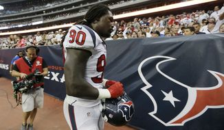 Houston Texans' Jadeveon Clowney (90) leaves with a knee injury during the second quarter of an NFL football game against the Washington Redskins, Sunday, Sept. 7, 2014, in Houston. (AP Photo/Patric Schneider)
