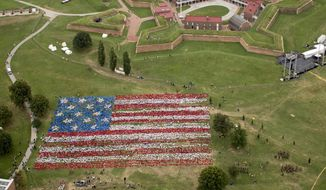 """Over 6,000 school children assembled into a """"living"""" American flag at Fort McHenry, all to celebrate the 200th anniversary of """"The Star Spangled Banner"""" on Tuesday. (National Park Service)"""