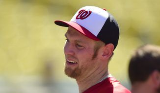 Washington Nationals pitcher Stephen Strasburg before the start of a baseball game against the Los Angeles Dodgers, Monday, Sept. 1, 2014, in Los Angeles. (AP Photo/Gus Ruelas)