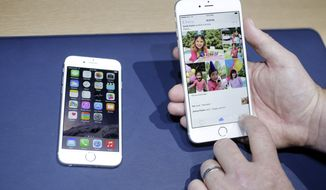 The iPhone 6, at left, and iPhone 6 plus are shown next to each other during a new product release on Tuesday, Sept. 9, 2014, in Cupertino, Calif. (AP Photo/Marcio Jose Sanchez)