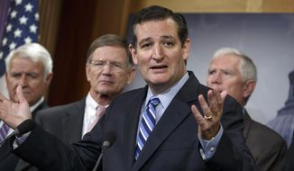 Sen. Ted Cruz, R-Texas, criticizes President Barack Obama, saying he has not taking a stand on the immigration crisis on the U.S.-Mexico border and is putting off executive action until after the politically-charged midterm election in November, Tuesday, Sept. 9, 2014, during a news conference on Capitol Hill in Washington. From left are, Rep. John Carter, R-Texas, Rep. Lamar S. Smith, R-Texas, Cruz, and Rep. Mo Brooks, R-Ala. Cruz said that the reason unaccompanied minors flooded the Southwest border during the summer is that they believe they will get amnesty and be allowed to stay in the United States. (AP Photo/J. Scott Applewhite)