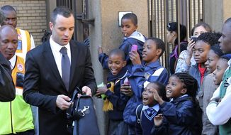 File: In this Monday May, 12, 2014, file photo Oscar Pistorius outide the HIgh Court in Pretoria, South Africa. Presiding Judge Thokozile Masipa is expected to announce her verdict in Pistorius' murder trail after scrutinizing evidence Thursday and Friday given by 37 witnesses in a court transcript running to thousands of pages in a drama that has played out over six months. (AP Photo/Themba Hadebe, File)