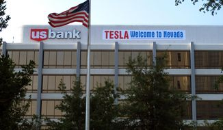 "A banner welcoming Tesla to Nevada is hung on the US Bank building just south of the downtown Reno casino district on Tuesday, Sept. 9, 2014,  in Renvo, Nev. State lawmakers planned to meet in a special legislative session in Carson City on Wednesday to consider a package of tax breaks and incentives worth up to $1.3 billion to seal a deal to bring the electric car maker's $5 billion lithium battery ""gigafactory'' to an industrial park in the state. (AP Photo/Scott Sonner)"