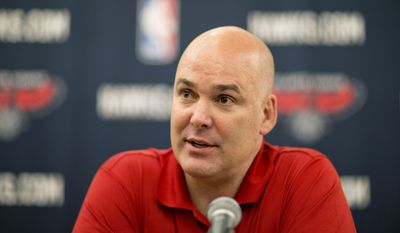 "FILE - In this July 10, 2013, file photo, Atlanta Hawks general manager Danny Ferry speaks at a press conference in Atlanta. Ferry has been disciplined by CEO Steve Koonin for making racially charged comments about Luol Deng when the team pursued the free agent this year. Ferry apologized Tuesday, Sept. 9, 2014,  for ""repeating comments that were gathered from numerous sources"" about Deng. (AP Photo/David Goldman, File)"