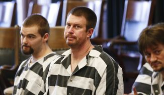 FILE - In this May 8, 2012, file photo, former NFL quarterback Ryan Leaf, center, sits in a Cascade County courtroom in Great Falls, Mont. Leaf has been sentenced to five years in prison in Texas for violating terms of his probation. (AP Photo/The Great Falls Tribune, Larry Beckner, File)  NO SALES