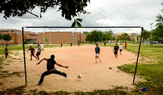 Schools might be more successful getting kids to eat well if they schedule recess before lunch instead of after it, a new, limited study found. Kids who ate school lunch after recess ate 54 percent more vegetables. (Andrew Harnik/The Washington Times)