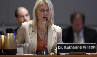 National Transportation Safety Board (NTSB) investigator Katherine Wilson testifies about pilot fatigue during a hearing at the NTSB in Washington, Tuesday, Sept. 9, 2014. The NTSB was meeting to discuss UPS Flight 1354 plane crash. The UPS plane, an Airbus A300-600F, crashed shortly before dawn on Aug. 14, 2013, as it was preparing to land in Birmingham. It hit trees and a utility pole before slamming into a hillside and bursting into flames. (AP Photo/Susan Walsh)