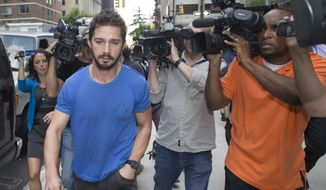 "** FILE ** In this June 27, 2014, file photo, actor Shia LaBeouf walks through the media after leaving Midtown Community Court in New York following his arrest the previous day for yelling obscenities at the Broadway show ""Cabaret."" LaBeouf on Wednesday, Sept. 10, 2014, pleaded guilty to disorderly conduct stemming from the incident. (AP Photo/John Minchillo, File)"