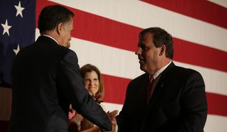 New Jersey Gov. Chris Christie, right, shakes hands with former Republican presidential contender Mitt Romney at an event celebrating Christie's 52nd birthday, Wednesday, Sept. 10, 2014, in East Brunkswick, N.J. (AP Photo/Julio Cortez) ** FILE **