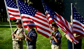 Members of the Boy Scouts of America stand outside the Gerald R. Ford Presidential Museum to welcome the Patriot Guard Riders as they escort a 9/11 mobile exhibit to the museum in Grand Rapids, Mich., on Tuesday, Sept. 9, 2014. Thursday marks the 13th anniversary of the Sept. 11 terror attacks.  (AP Photo/The Grand Rapids Press, Emily Rose Bennett)