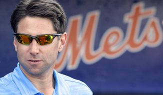 New York Mets chief operating officer Jeff Wilpon, son of Mets principal owner Fred Wilpon, stands near the Mets dugout before a spring training baseball game against the Washington Nationals in Port St. Lucie, Fla., Tuesday, March 20, 2012.  (AP Photo/Patrick Semansky)