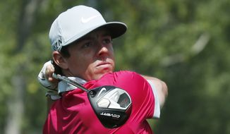 Rory McIlroy, of Northern Ireland, follows his shot off the second tee in the third round of the BMW Championship golf  tournament in Cherry Hills Village, Colo., Saturday, Sept. 6, 2014. (AP Photo/David Zalubowski)