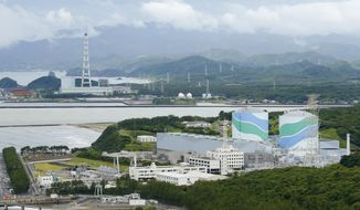 This June 2013 photo shows an overview of Sendai nuclear power plant complex in Sendai, Kagoshima Prefecture, southern Japan. The plant in southern Japan won regulators' approval Wednesday, Sept. 10, 2014 for meeting safety requirements imposed after the 2011 Fukushima disaster, a key step toward becoming the first reactor to restart under the tighter rules.  (AP Photo/Kyodo News) JAPAN OUT, MANDATORY CREDIT