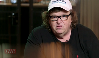Michael Moore took to Facebook Monday morning to celebrate the Supreme Court's ruling on gay marriage and blast white conservatives as ignorant and hateful. (The Hollywood Reporter) ** FILE **