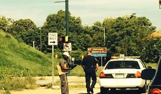 An Indianapolis police officer's random act of kindness has gone viral thanks to Indiana Pacers player Roy Hibbert, who tweeted a photo of the officer giving a homeless man a pair of shiny black boots. (Roy Hibbert/Twitter)