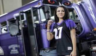 Racquel Bailey wears a Ray Rice jersey as she tailgates before the Baltimore Ravens' NFL football game against the Pittsburgh Steelers on Thursday, Sept. 11, 2014, in Baltimore. (AP Photo/Patrick Semansky)