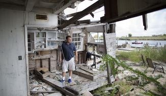 In this Sept. 5, 2014 photo, Gary Silberman stands for a picture as he guides reporters on a tour of his parent's home that was destroyed by Superstorm Sandy, in Lindenhurst, N.Y. After receiving nearly $17,000 in assistance from FEMA, the agency is demanding a return on the funds. (AP Photo/John Minchillo)