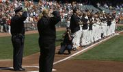 San Francisco Police Chief Greg Suhr, left and Fire Chief Joanne Hayes-White salute next to San Francisco Giants players who stand on the line to honor 9/11 during the national anthem before a baseball game against the Arizona Diamondbacks in San Francisco, Thursday, Sept. 11, 2014. (AP Photo/Jeff Chiu) ** FILE **