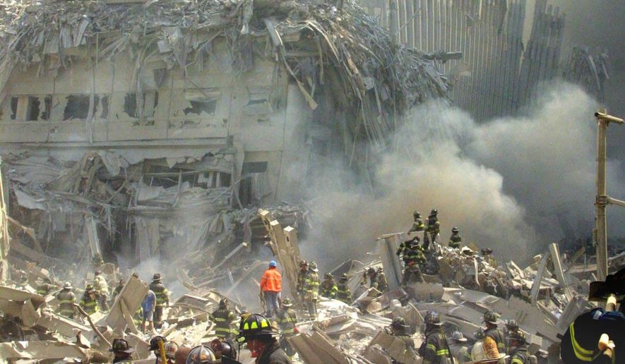 FILE - In this Sept. 11, 2001 file photo, a shell of what was once part of the facade of one of the twin towers of New York's World Trade Center rises above the rubble that remains after both towers were destroyed in New York. Whether they survived the attacks by fleeing the buildings, worked at the site after the attacks or simply lived near-by, people are still dealing with the emotion effects of the attacks 13 years later.   (AP Photo/Shawn Baldwin, File)