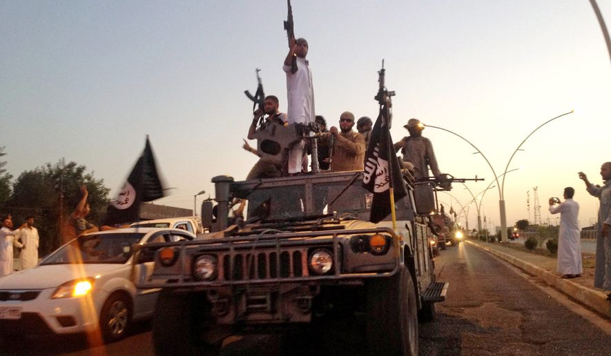 Fighters from the Islamic State group parade in an Iraqi security forces armored vehicle. Experts say defeating the group is more akin to what was required to beat al Qaeda in Iraq, which was founded in 2004 by Jordanian Abu Musab al-Zarqawi and subsequently led by the group's current chief, Abu Bakr al-Baghdadi, an Iraqi cleric. (Associated Press)