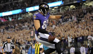 Baltimore Ravens tight end Owen Daniels celebrates his touchdown reception during the first half of an NFL football game against the Pittsburgh Steelers on Thursday, Sept. 11, 2014, in Baltimore. (AP Photo/Nick Wass)