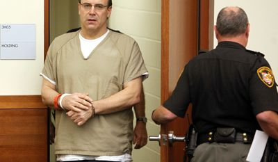 Former Ohio State and NFL quarterback Art Schlichter, left, enters the Franklin County Common Pleas Court Thursday, Sept 15, 2011, in Columbus, Ohio. In a deal with prosecutors, Schlichter pleaded guilty Thursday to 13 counts and was sentenced to 10 years in prison. The 51-year-old Schlichter also is expected to plead guilty soon to federal charges of bank and wire fraud and filing a false tax return. (AP Photo/Terry Gilliam)