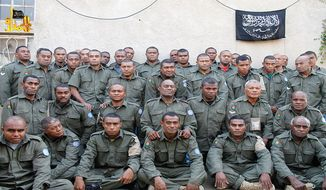 ** FILE ** This undated file image attached in a statement released on Saturday, Aug. 30, 2014, on the Hanin Network website, a militant website, shows Fijian U.N. peacekeepers who were seized by The Nusra Front on Thursday, Aug. 28, 2014, in the Golan Heights in the buffer zone between Syria and Israel. Fiji confirmed Thursday that soldiers shown in a new video posted online are its 45 United Nations peacekeepers being held captive in Syria. (AP Photo/Hanin Network Website, File)