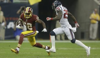 Washington Redskins wide receiver Andre Roberts (12) runs against Houston Texans cornerback Kareem Jackson (25) during the third quarter of an NFL football game Sunday, Sept. 7, 2014, in Houston. (AP Photo/Patric Schneider)