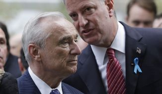 New York City Police Commissioner Bill Bratton and Mayor Bill de Blasio talk during memorial observances held at the site of the World Trade Center in New York, Thursday, Sept. 11, 2014.  Family and friends of those who died read the names of the nearly 3,000 people killed in New York, at the Pentagon and near Shanksville, Pennsylvania.(AP Photo/Mark Lennihan, Pool)