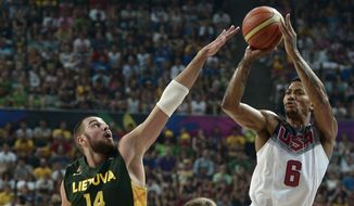 United States's Rudy Gay goes up for a basket against Lithuania's Jonas Valanciunas , left, and Renaldas Seibutis during their Basketball World Cup semifinal match at the Palau Sant Jordi in Barcelona, Spain, Thursday, Sept. 11, 2014. The 2014 Basketball World Cup competition will take place in various cities in Spain from Aug. 30 through Sept. 14. (AP Photo/Manu Fernandez)