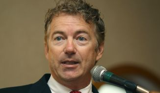 """U.S. Sen. Rand Paul, R-Ky., speaks  Friday, Sept. 12, 2014 at a GOP unity breakfast in Manchester, N.H.  Paul considered a possible Republican presidential candidate in 2016, made a visit to the key early voting state of New Hampshire at the state Republican Party's """"Unity Breakfast"""" following Tuesday's state primary. (AP Photo/Jim Cole)"""