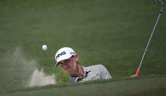 Billy Horschel hits out of a greenside bunker on the 13th hole during the second round of play in the Tour Championship golf tournament  Friday, Sept. 12, 2014, in Atlanta. (AP Photo/John Bazemore)