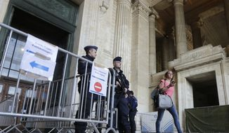 Police guard the entrance of the Palais de Justice as sole suspect of the Brussels Jewish museum shooting Mehdi Nemmouche appears before a judicial hearing, in Brussels, Sept. 12, 2014. Mehdi Nemmouche, a 29-year-old French national who is believed to have links with radical Islamists and have fought in Syria, was arrested in France in connection with the shooting, and extradited to Belgium in July. (AP Photo/Yves Logghe)