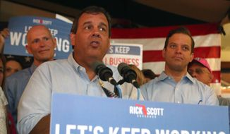 New Jersey Gov. Chris Christie speaks at a support rally for Florida Gov. Rick Scott  on Friday, Sept. 12 in Panama City Beach, Fla. Christie is helping Scott campaign in his  tight race with Republican-turned-Democrat former Gov. Charlie Crist. (AP Photo/News Herald, Patti Blake) MANDATORY CREDIT