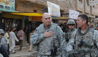 Gen. Ray Odierno, Commanding General, Multi-National Forces-Iraq, and U.S. Army Lt. Col. Joseph McGee, Commander of 2-327 Infantry Battalion, 1st Brigade Combat Team, 101st Airborne Division, walk through the streets of Samarra to visit the locals, on Oct. 29, 2008. (U.S. Army) ** FILE **