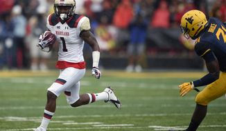 Maryland wide receiver Stefon Diggs (1) runs with the ball against West Virginia linebacker Isaiah Bruce, right, during the first half of an NCAA football game, Saturday, Sept. 13, 2014, in College Park, Md. (AP Photo/Nick Wass)